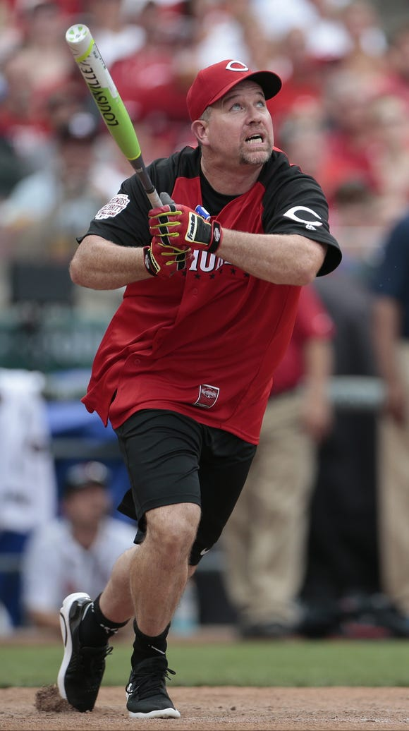 Sean Casey watches his home run sail over the fence.