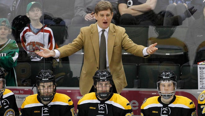 Michigan Tech head coach Mel Pearson, top, questions a call during the third period of the WCHA Final Five college championship hockey game against Minnesota State Mankato in St. Paul, Minn., Saturday, March 21, 2015.