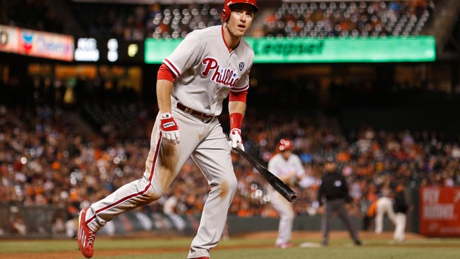 The Phillies' Chase Utley takes his base after San Francisco Giants pitcher Javier Lopez hit Utley with a pitch, forcing a run scored as the bases were loaded during the tenth inning Friday in San Francisco.