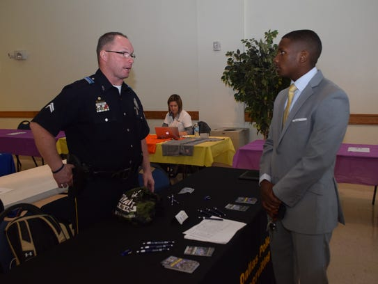 Senior Cpl. Dane White (left) of the Dallas Police