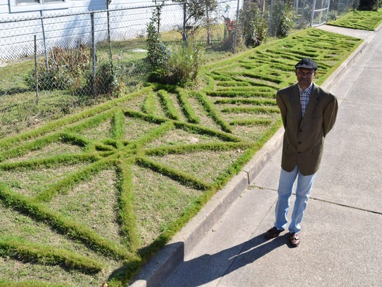 Arthur Brown creates patterns in his yard using a lawn