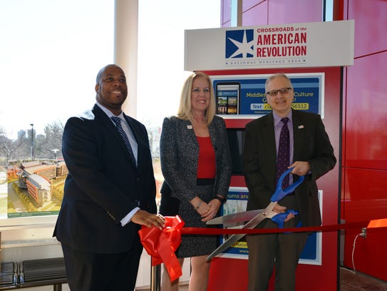 Cutting the ribbon on the tourism kiosk are (from left)