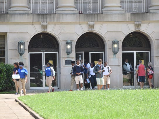 Students leave Bolton High School as the final bell