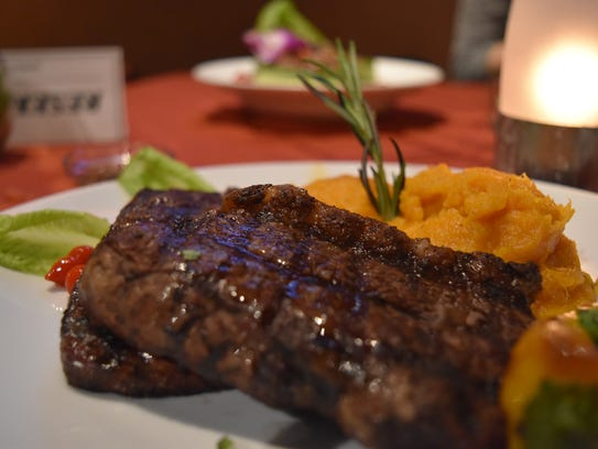 Picanha steak served with chimichurri sauce and mashed sweet potatoes at El Gaucho Inca.