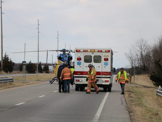 Rescue personnel work at the scene of a multiple injury