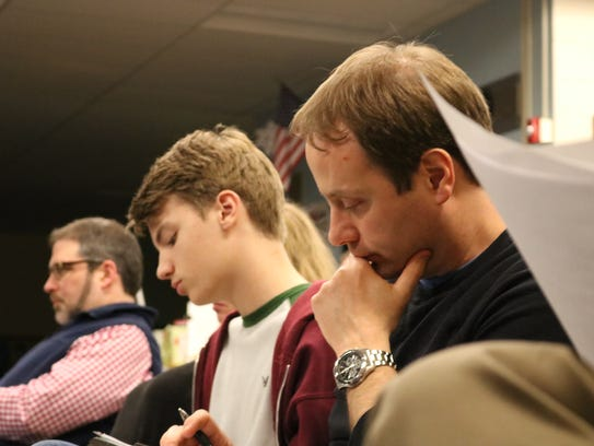 Community member Dan Emmons, right, and student Cole