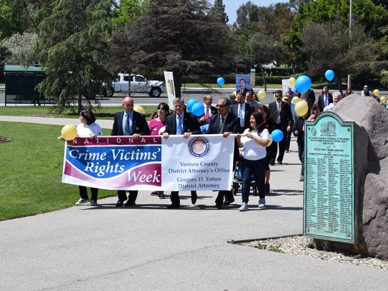 Ventura County District Attorney Greg Totten and county Supervisor John Zaragoza lead a march around the Government Center in recognition of National Crime Victims' Rights Week in 2017.
