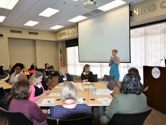 Frances McIntosh speaks at the Acadiana Women's Network