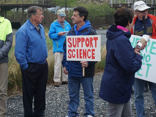 """Mark Walter of Frankford holds a """"Support Science"""""""