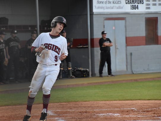 Tate's Mason Land crosses the plate with Tate's first