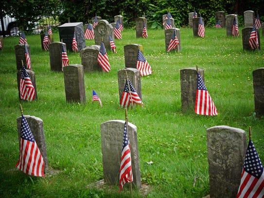 Headstones mark the resting place of Civil War veterans