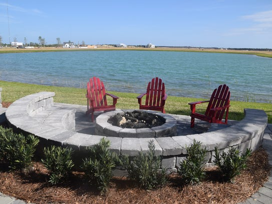 Outside the fire pit area is secluded in a stone semi-circle.