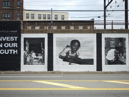 """Akintola Hanif's """"Invest in our Youth"""" mural in Newark."""