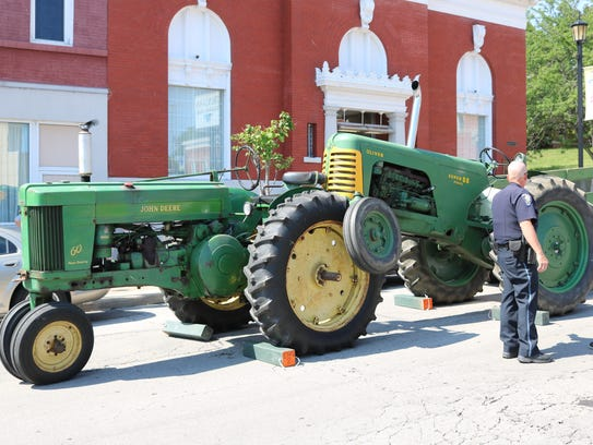 An antique tow truck reportedly crashed into a tractor,