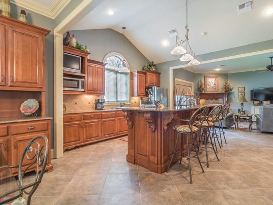 The kitchen is large and open with lots of natural
