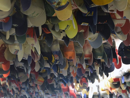 This is just some of the many hats that adorn the ceiling