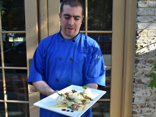 Jackson's Steakhouse sous chef Ross Johnson displays