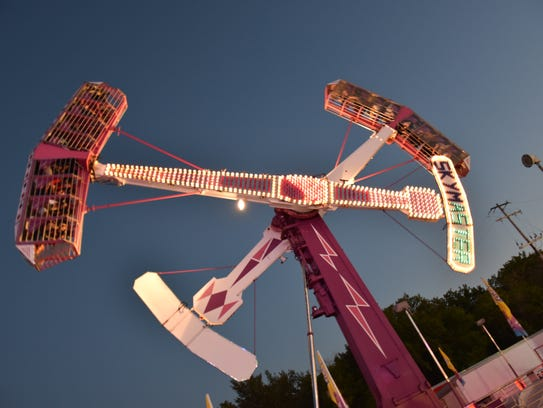 The Sky Master spins fair-goers around at the Wisconsin
