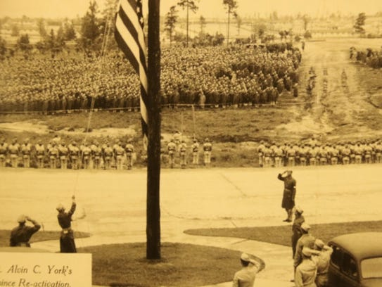 Sergeant Alvin C. York salutes the flag at the flag