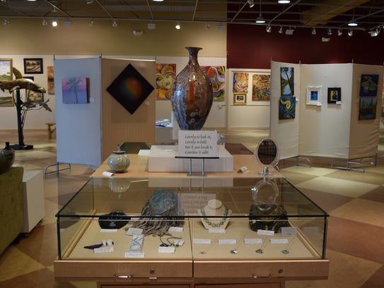 Vases, homemade bags and jewelry are on display in