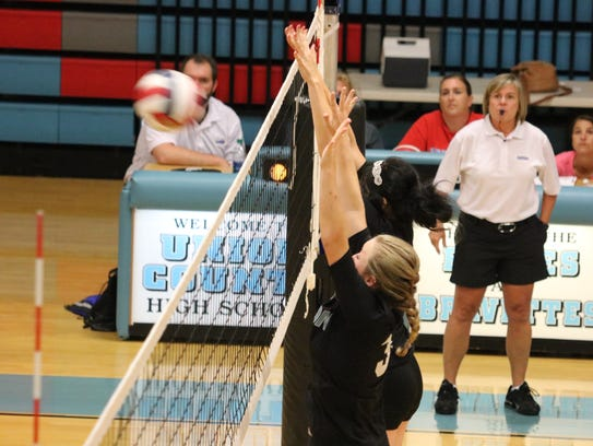 Grace Mills and Lexi Smith go for the block during