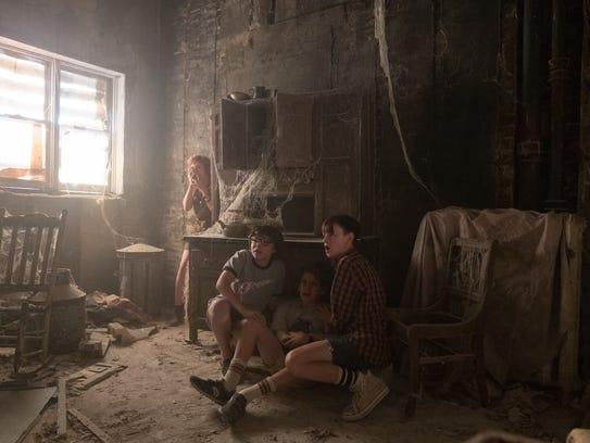 Sophia Lillis (from left), Finn Wolfhard, Jack Dylan