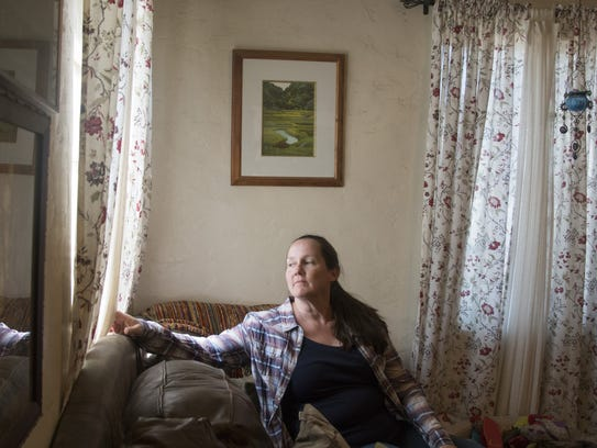 Christine Close, pictured inside her home in Mesa's