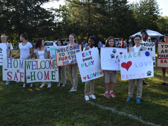 Girl Scout Troops made signs to welcome the Animal