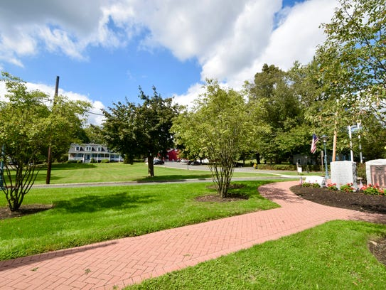 There is a view of the Tappan Village green from the