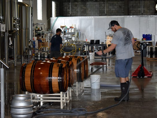 Walking Tree's Jordan Farrow starts early in the day making sure their craft beers meet the exacting standards set by the brewery.