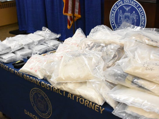 Heroin and fentynal are shown after a drug bust.