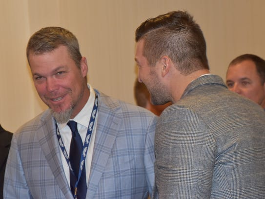 Chipper Jones and Tim Tebow meet during  at the 2017 Florida Sports Hall of Fame enshrinement ceremony at the Sawgrass Marriott Resort at Ponte Vedra Beach, not far from the TPC-Stadium Course and PGA Tour headquarters.
