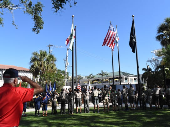 U.S. veteran Harold Pappy Wagner salutes the flag during