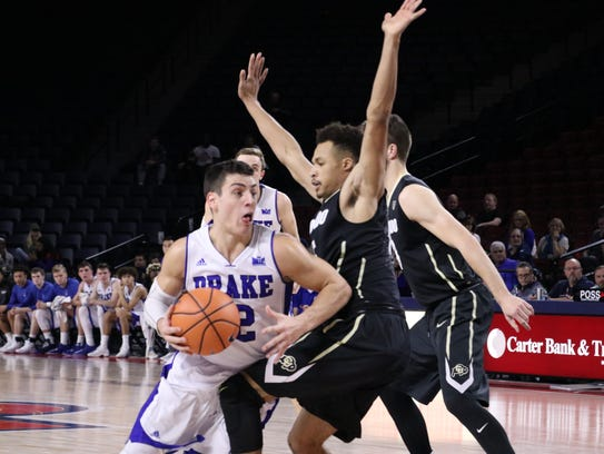 Drake's Reed Timmer tries to drive to the rim against