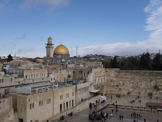 A view of the Western Wall and the golden Dome of the