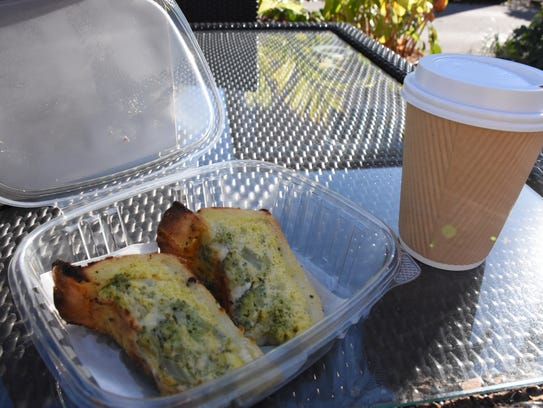 9 a.m. Ashley Collins begins her day with a pumpkin spice latte and broccoli cheddar quiche at Kunjani Craft Coffee & Gallery on Seagate Drive in Naples on Jan. 4, 2018.