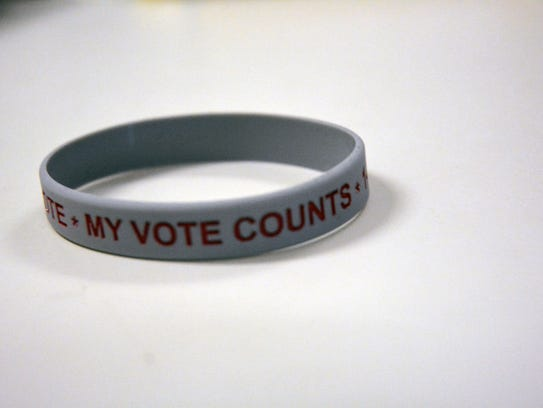 One of the bracelets being handed out to homeless voters