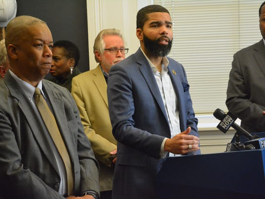 Jackson Mayor Chokwe Antar Lumumba, left, stands with interim Police Department Chief Anthony Moore at a press conference.