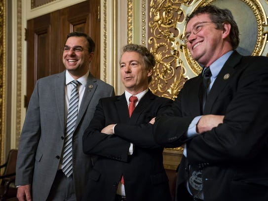 Republican Senator from Kentucky Rand Paul (center)
