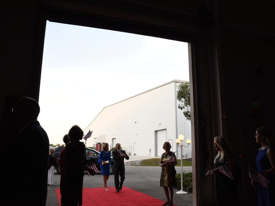 People start arriving at the Flexjet Hangar in the