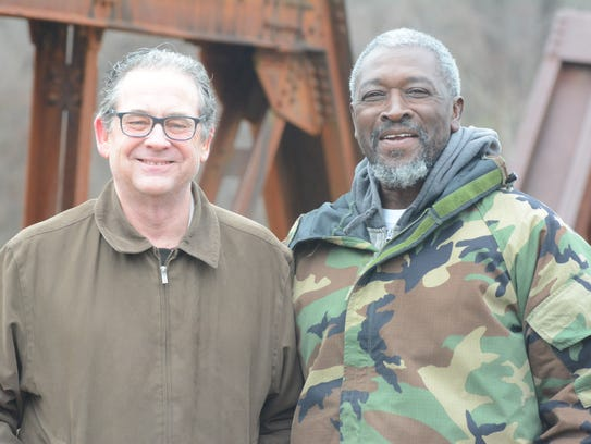 Dallas-based CPA Russell Davis, left, stands with Village