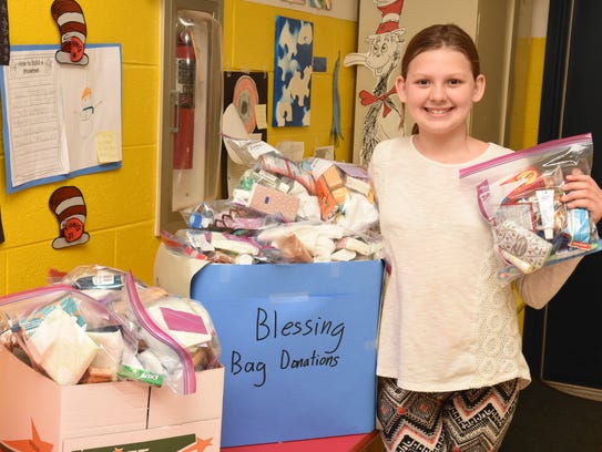 Paige LeQuire packs up a box with Blessing Bags to