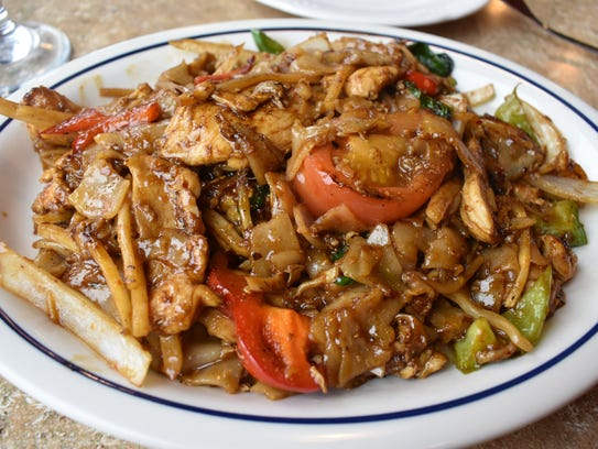 Phad Kee Mao is a stir-fried Thai noodle dish with