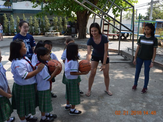 St. Paul Christian Warriors Monica Giger helps students