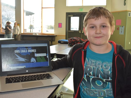 Matthew Anderson, 11, shows off his website for the