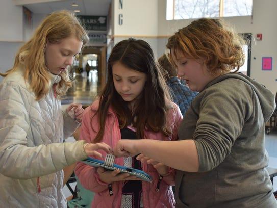 Aurora Farley, 12, Lillian Fredrickson, 12, and Mattearose