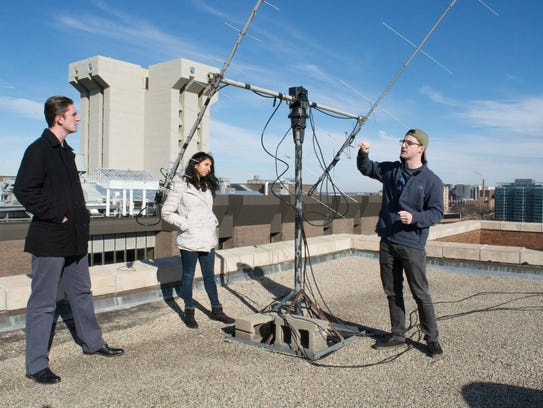 Alex McGlasson, Himadri Pandey and Adam Herrmann are part of a group of UC engineering and computer science students building satellitesabout the size of a Rubik's Cube tostudy harmful radiation with NASA.