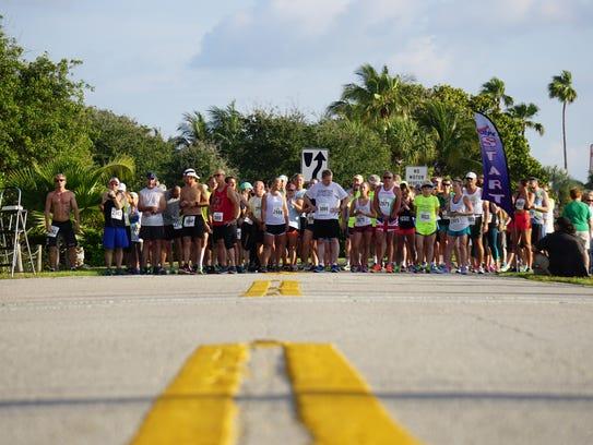 "Participants in the ""Hop for Habitat""5K Run/Walk wait"
