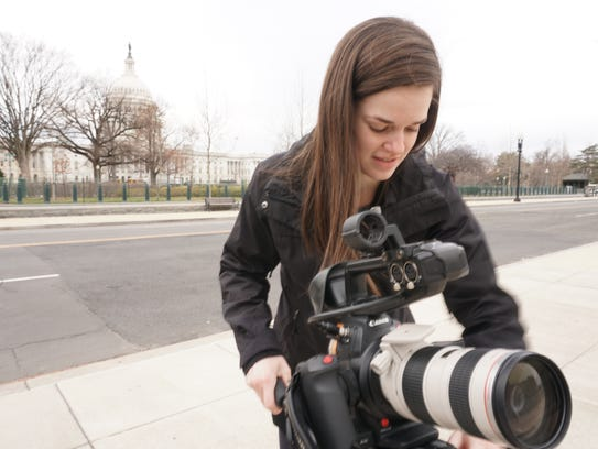 UT journalism student Story Sims shoots exteriors of