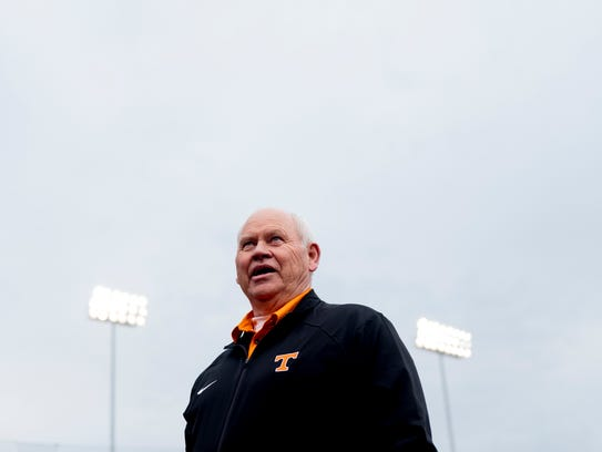 Phillip Fulmer greets fans during a game between Tennessee